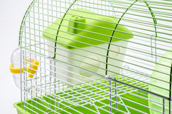 Close up A yellow box in a small yellow hamster cage. Royalty Free Stock Images