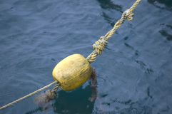 Yellow Buoy in the Water Royalty Free Stock Photography