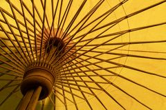 A close-up of a yellow calico umbrella from the inside. royalty free stock image