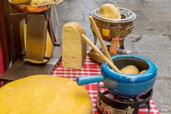 Close up yellow cheeses and potato in the and on table near mark. Et in europe Stock Photography