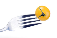 Close up of yellow cherry tomato on fork Stock Images