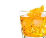 Close-up of yellow cocktail with orange slice isolated on white background, focus on slice Royalty Free Stock Image