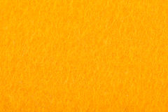 Close up of yellow colored felt textile for background Stock Photo