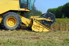 Close up of a yellow combine harvester Royalty Free Stock Photo