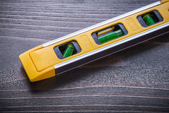 Close up of yellow construction level on vintage Royalty Free Stock Photography
