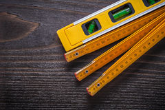 Close up of yellow construction level with wooden Royalty Free Stock Image
