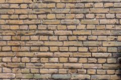 Close-up yellow and darkly tinted vintage brick wall. With clear cement lines between the stones. Great for a backdrop Stock Photos