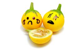 Close Up Yellow Eggplant with Sad Face and Dissect on White Background. Great For Any Use Royalty Free Stock Photography