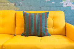 Close up of yellow fabric sofa and cushions Royalty Free Stock Images
