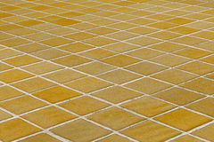 Close-up of yellow glazed tile floor/wall Royalty Free Stock Image