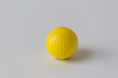 Close up of yellow golf ball Royalty Free Stock Photography
