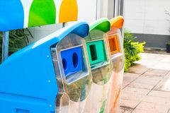 Close up yellow, green, blue recycle bins with recycle symbol in stock photo