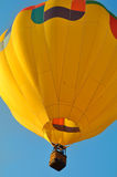 Close up of a yellow hot air balloon. Beautiful scene with hot air balloon in the blue sky Stock Images