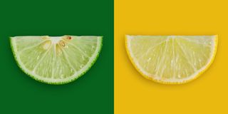 Lemon and lime slice and fresh citrus fruit on yellow and green. Close up of yellow lemon and green lime on the yellow and green background, Fresh lemon and lime Royalty Free Stock Photography