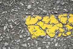 Close-up of yellow line on road texture Stock Images