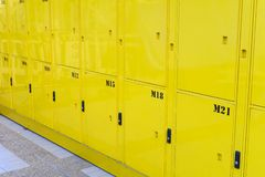 Close up on yellow lockers door at public locker service.  royalty free stock images