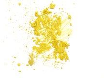 Close up of yellow make up powder and crushed eyeshadow. Stock Photo
