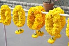 Yellow marigold flower garland. Close up yellow marigold flower garland royalty free stock photography