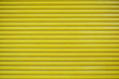 Close up yellow metal sheet slide door texture background. Royalty Free Stock Photo