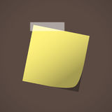 Close up of yellow note paper reminder on brown background Royalty Free Stock Photos