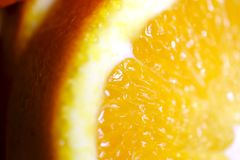 Close up yellow orange slices. Quite close up photo of bright yellow orange slices on some pure white surface. Citrus are one of the most popular food Stock Images