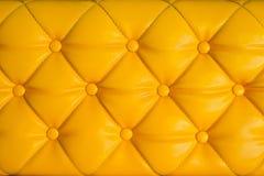 Yellow retro chesterfield style, capitone textile background. Close up yellow retro chesterfield style, capitone textile background Stock Image