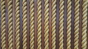 Close up yellow rough rope for texture Backgroud. A rope is a group of yarns, plies, or strands that are twisted or braided together into a larger and stronger royalty free stock images