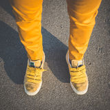 Close up of yellow shoes legs Stock Images