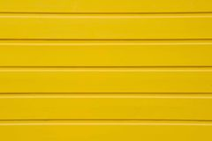 Close up of yellow wooden panel background- texture Stock Photos
