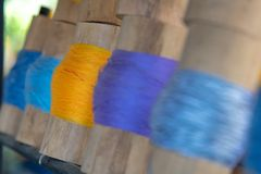 Close up Yellow yarn focused wrapped around bamboo tube Stock Images