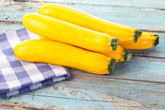Close up of yellow zucchini on checked napkin Stock Photography