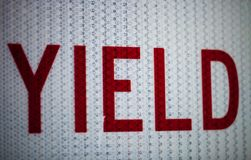 Close up of yield sign. Close up of old yield traffic sign royalty free stock images