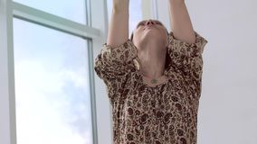 Close-up of yoga girl wearing special clothes and accessories calming breathing stock footage