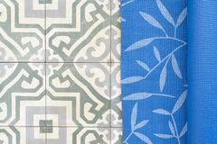 Close up of yoga mat on retro floor tile royalty free stock photos