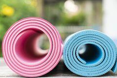 Close up of yoga mats on the table stock image