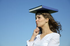 Close up of youg beautiful girl with a blue book Royalty Free Stock Photo