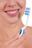 Close-up of a yougn woman smile with toothbrush Royalty Free Stock Image
