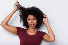 Free Close Up Young African Woman Pulling Bad Curly Hair And Looking Worried Royalty Free Stock Photos - 112576878