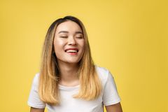 Close up of young Asian beautiful woman with smiley face.  royalty free stock image