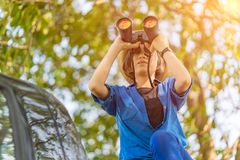 Close up Woman wear hat and hold binocular in grass field royalty free stock photos