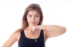 Close-up of young athletic girl who is holding one arm bent Royalty Free Stock Photos