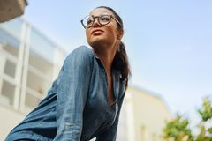 Close up of young attractive bespectacled woman looking aside. royalty free stock photography