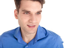 Close up of a young attractive man smiling. While looking away from the camera Royalty Free Stock Images