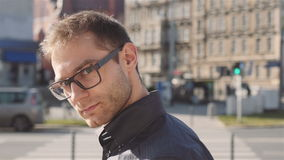 Close up of young attractive smiling man wearing eye glasess, outdoors. stock video