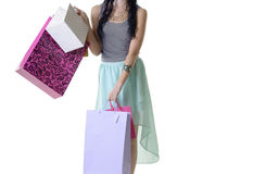 Close up of young attractive woman carrying shopping parcels Stock Photo