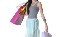 Close up of young attractive woman carrying shopping parcels Royalty Free Stock Photo