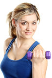Close up of a young attractive woman with weights royalty free stock photography