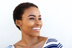 Close up young back woman smiling against white background Royalty Free Stock Images