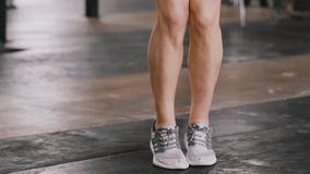 Close-up young beautiful blonde woman working out with jump rope in atmospheric gym slow motion. Healthy lifestyle. Close-up young beautiful blonde woman stock video footage