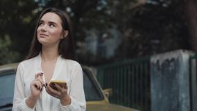 Close Up of Young Beautiful Brunette Girl Using her Modern Smartphone for Communication, Typing Message while Standing stock video footage